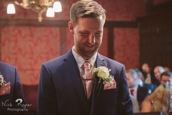 Close up of the groom anxiously waiting
