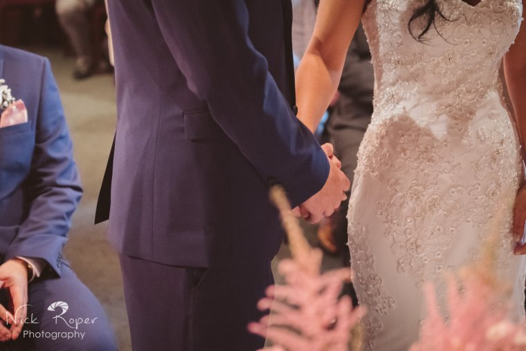 Bride and Groom holding hands tightly
