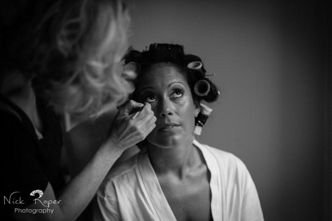 Bride having eye make up applied.