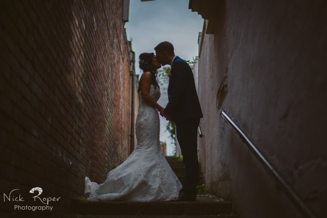 Portrait of Bride and groom in an alley