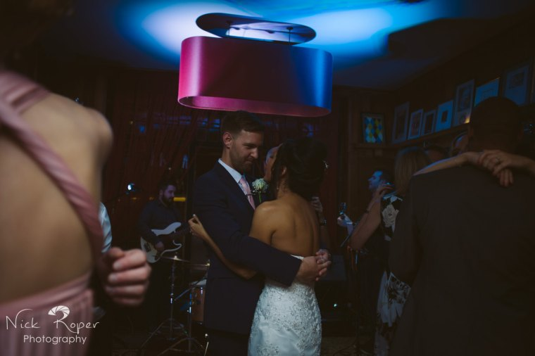 Bride and Groom dancing in the middle of the dance floor