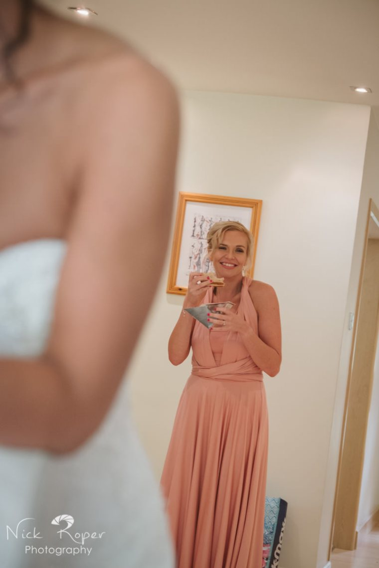 bridesmaid having a quick sandwich